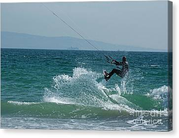 Kite Surfer Jumping Over A Wave Canvas Print