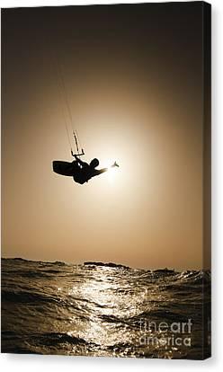 Kitesurfing At Sunset Canvas Print by Hagai Nativ