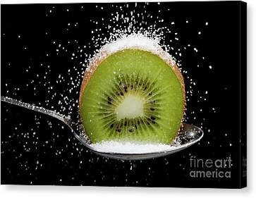 Kiwi Fruit Cut In Half On A Spoon With Sugar Canvas Print by Simon Bratt Photography LRPS