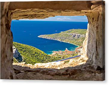 Komiza Bay Aerial View Through Stone Window Canvas Print by Brch Photography
