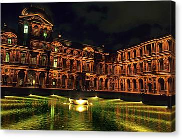 La Cour Carree And The Building Of The Louvre Illuminated At Night Canvas Print by Sami Sarkis
