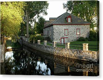 Lachine Canal Montreal Quebec Canvas Print by John  Mitchell