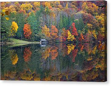 Lake Logan Boathouse In Fall Canvas Print by Mike McGlothlen