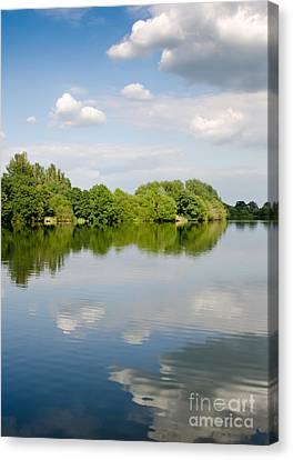 Lake Reflection Dinton Pastures Lakes And Nature Reserve Reading Berkshire Uk Canvas Print by Andy Smy