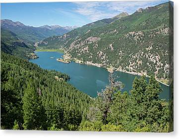Canvas Print featuring the pyrography Lake San Cristobal by Aaron Spong