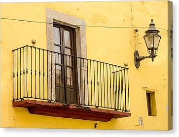 Lamp And Balcony On Yellow Stucco Wall Canvas Print by Rob Huntley