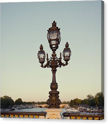 Lamp Post On The River Seine In Paris Canvas Print by Ivy Ho