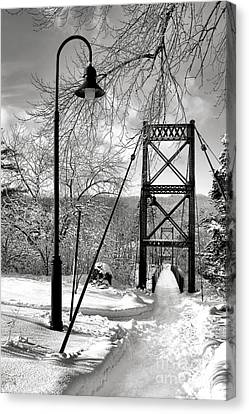 Lamppost And Androscoggin Swinging Bridge In Winter Canvas Print by Olivier Le Queinec