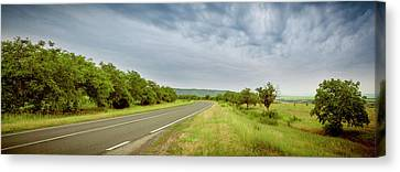 Landscape With Highway And Cloudy Sky Canvas Print