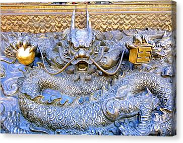 Canvas Print featuring the photograph Large Bronze Sculpture Of A Dragon by Yali Shi
