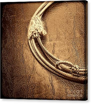 Lasso On Leather Canvas Print by American West Legend By Olivier Le Queinec