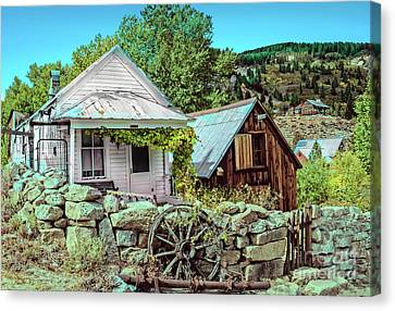 Wagon Wheels Canvas Print - Last Post Office And Ice House by Robert Bales