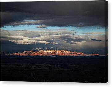 Canvas Print featuring the photograph Late Light On Red Rocks With Storm Clouds by Ron Chilston