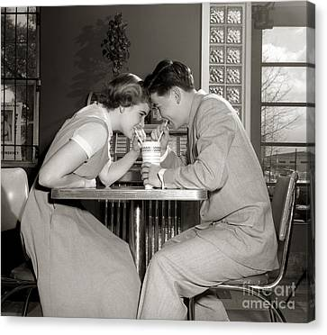 Laughing Couple Sharing A Drink Canvas Print by H. Armstrong Roberts/ClassicStock