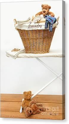 Laundry Basket With Teddy Bears On Floor Canvas Print by Sandra Cunningham