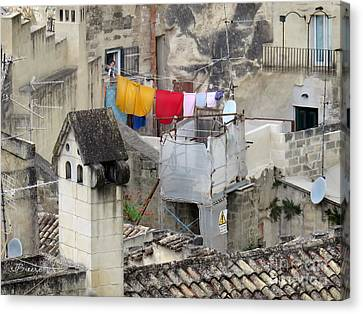 Laundry Day In Matera.italy Canvas Print by Jennie Breeze