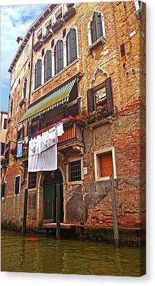 Canvas Print featuring the photograph Laundry Drying In Venice by Anne Kotan