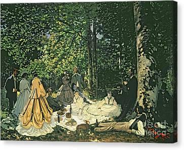 Le Dejeuner Sur Lherbe Canvas Print by Claude Monet