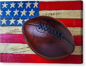 Leather Football On Flag Canvas Print by Garry Gay