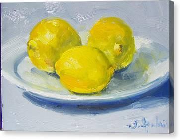 Lemons On A White Plate Canvas Print by Susan Jenkins