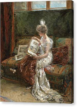 Leonie Garrido Looking At An Album Of Prints Canvas Print by Eduardo Leon Garrido