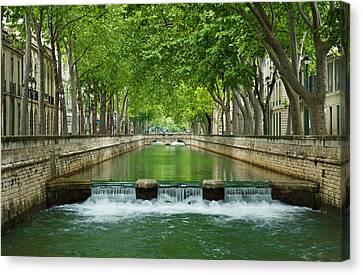 Les Quais De La Fontaine Canvas Print by Scott Carruthers