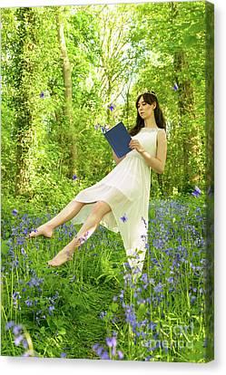 Levitating Woman Reading Book Canvas Print by Amanda Elwell
