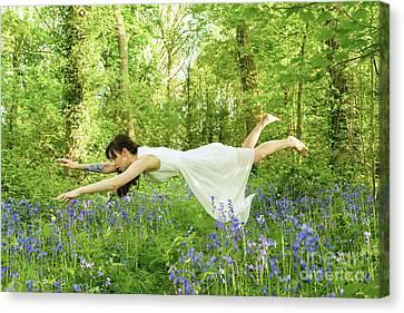 Levitation In The Bluebells Canvas Print by Amanda Elwell
