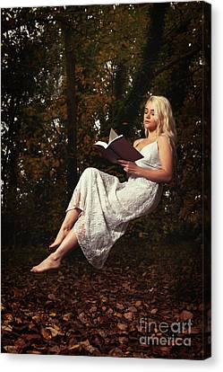 Levitation With Book Canvas Print
