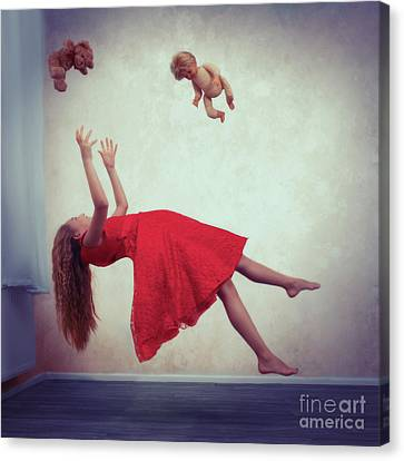 Levitation With Toys Canvas Print by Amanda Elwell