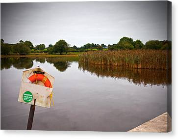 Lifebelt And Sign For The Samaritans Canvas Print by Panoramic Images