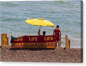 Windbreaker Canvas Print - Lifeguards At Work by Robert Jenkin
