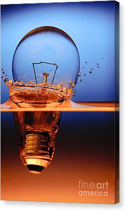 Glass Canvas Print - Light Bulb And Splash Water by Setsiri Silapasuwanchai