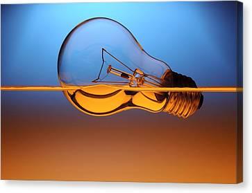 Light Bulb In Water Canvas Print by Setsiri Silapasuwanchai