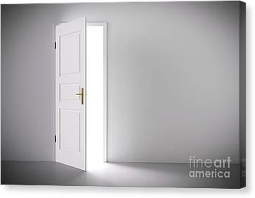 Light Coming From Half Open Classic White Door. Canvas Print by Michal Bednarek