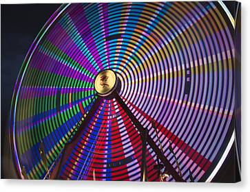 Light Effect Of A Fairground Ride Canvas Print by Philippe Widling