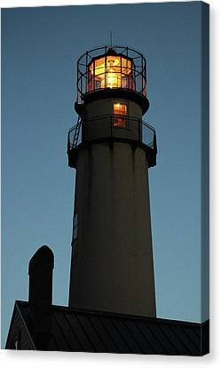 Lighthouse Aglow Canvas Print by Robert Banach