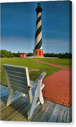 Lighthouse And Chair Canvas Print by Steven Ainsworth