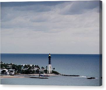 Lighthouse And Rain Clouds Canvas Print