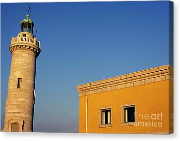 Lighthouse And Yellow Building At The Entrance Of The Port Of Marseille Canvas Print by Sami Sarkis