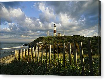 Lighthouse At Montauk With Dramatic Sky Canvas Print by Skip Brown