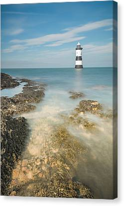 Lighthouse At Penmon Canvas Print by Andy Astbury