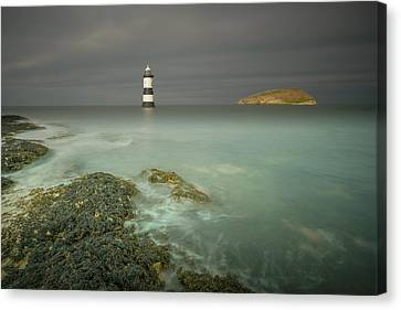 Lighthouse At Penmon Point Canvas Print by Andy Astbury