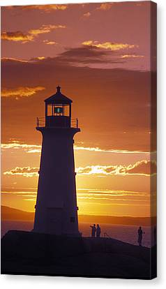 Lighthouse At Sunset In Peggys Cove Canvas Print by Richard Nowitz