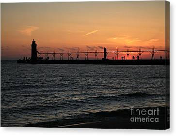 Lighthouse At Sunset Canvas Print by Timothy Johnson