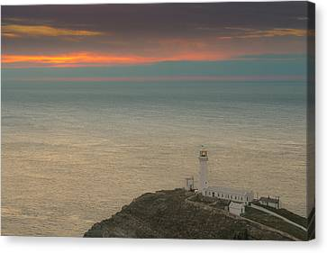 Lighthouse At Sunset,south Stack, Anglesey,north Wales Canvas Print by Andy Astbury