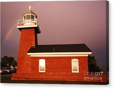 Lighthouse In A Rainbow Canvas Print