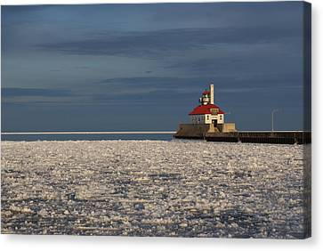 Lighthouse In Winter Canvas Print by Ron Read