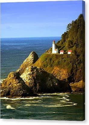 Lighthouse On The Oregon Coast Canvas Print by Marty Koch
