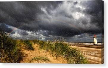 Lighthouse Rainbow Canvas Print by Adrian Evans